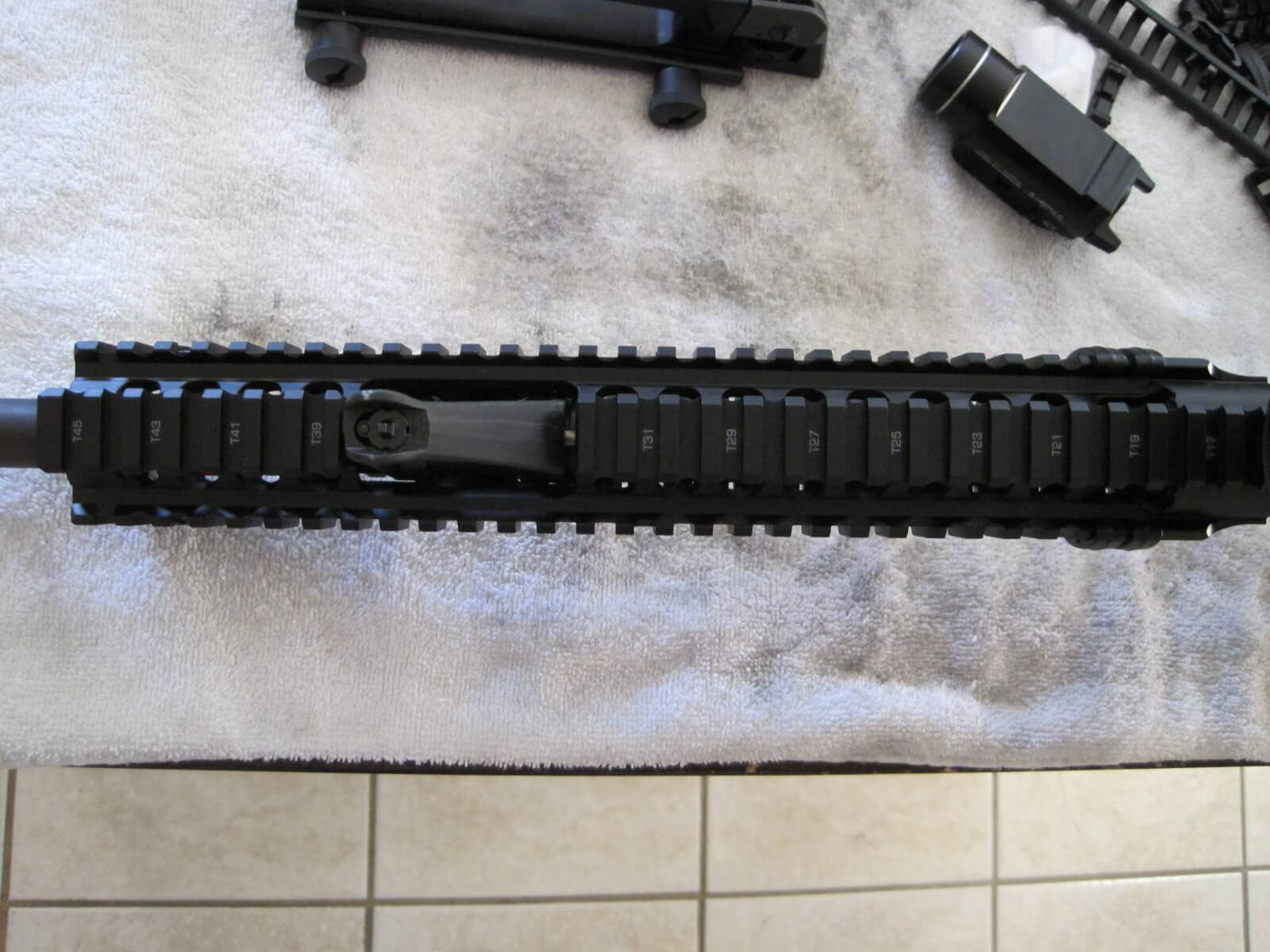 Check alignment of top of receiver and  Daniel Defense Omega X FSP Rail